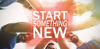 Composite image of start something new. Start something new against people forming hands stack at camp Stock Photo