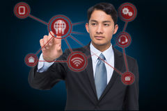 Composite image of stern asian businessman pointing stock image