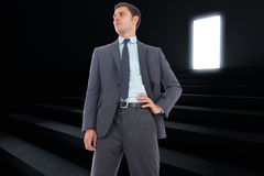 Composite image of stern businessman with hand on hip Royalty Free Stock Image