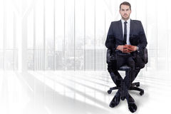 Composite image of stern businessman sitting on an office chair. Stern businessman sitting on an office chair  against high angle view of city Royalty Free Stock Photography
