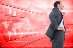 Composite image of stern businessman standing with hands on hips Royalty Free Stock Photos