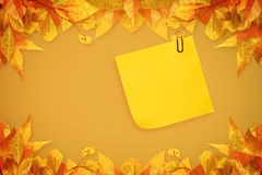 Composite image of  sticky note with grey paperclip Royalty Free Stock Photo