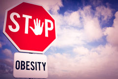 Composite image of stop obesity. Stop obesity  against blue sky with white clouds Royalty Free Stock Photos