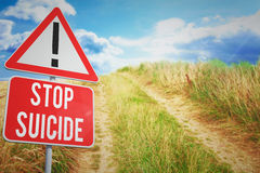 Composite image of stop suicide. Stop suicide against blue sky over sand dunes Royalty Free Stock Image