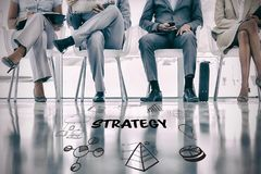 Composite image of strategy text with various web icons. Strategy text with various web icons against low section of business people waiting Stock Photos
