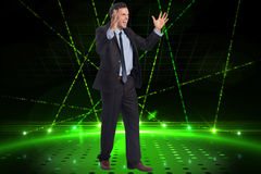 Composite image of stressed businessman gesturing Stock Images