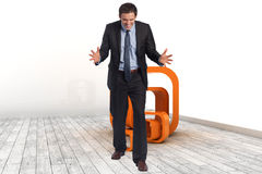 Composite image of stressed businessman gesturing Stock Photo