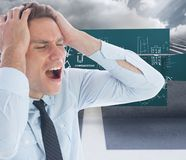 Composite image of stressed businessman with hands on head Royalty Free Stock Photo