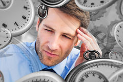 Composite image of stressed businessman holding his head Stock Images