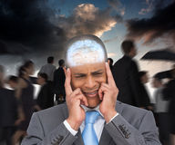 Composite image of stressed businessman putting his fingers on his temples Royalty Free Stock Photos