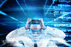 Composite image of stressed businessman touching his head Stock Photo