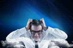 Composite image of stressed businessman touching his head Royalty Free Stock Photography