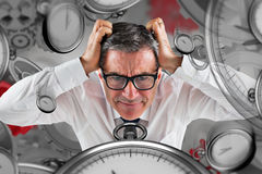 Composite image of stressed businessman touching his head Stock Image