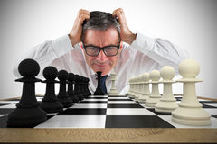 Composite image of stressed businessman touching his head Stock Images