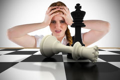 Composite image of stressed businesswoman with hands on head Royalty Free Stock Photography