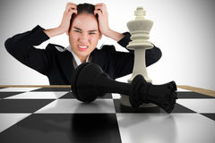 Composite image of stressed businesswoman with hands on her head Royalty Free Stock Photos