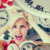 Composite image of stressed woman screaming and holding her head. Stressed woman screaming and holding her head against grey vignette stock photos