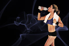 Composite image of strong blonde drinking from water bottle Stock Photos