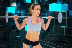 Composite image of strong female crossfitter lifting barbell behind head Stock Image