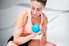 Composite image of strong woman doing bicep curl with blue dumbbell. Strong woman doing bicep curl with blue dumbbell against white wave design Royalty Free Stock Photography