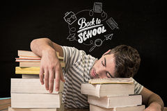 Composite image of student asleep in the library Royalty Free Stock Images