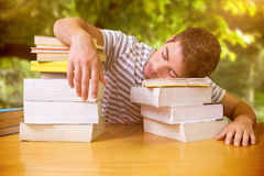 Composite image of student asleep in the library Stock Photography