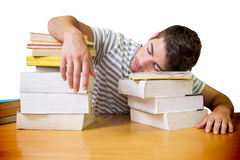 Composite image of student asleep in the library Stock Image