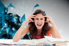 Composite image of student goes crazy doing her homework. Student goes crazy doing her homework against angular design Royalty Free Stock Photos