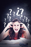 Composite image of student goes crazy doing her homework Royalty Free Stock Photography