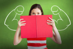 Composite image of student holding book over face Stock Images