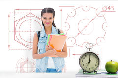 Composite image of student holding notebooks royalty free stock photo