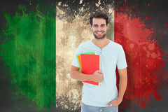 Composite image of student holding notepad Stock Image
