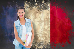 Composite image of student holding notepads Royalty Free Stock Photography