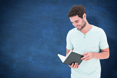 Composite image of student reading book Stock Photos