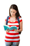 Composite image of student reading book in library Royalty Free Stock Photo