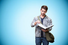Composite image of student reading in library Stock Photo