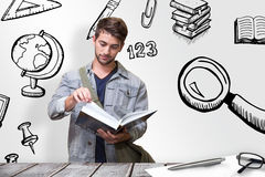 Composite image of student reading in library Stock Photography
