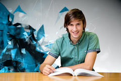 Composite image of student sitting in library reading Royalty Free Stock Photos
