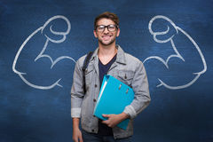 Composite image of student smiling at camera in library Stock Photos