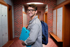 Composite image of student smiling at camera in library Stock Photo