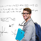 Composite image of student smiling at camera in library Royalty Free Stock Photography