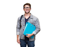 Composite image of student smiling at camera in library Stock Images