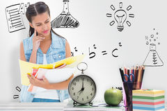 Composite image of student studying from folders Stock Photography