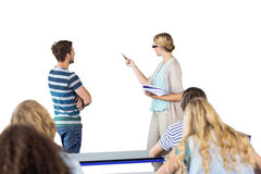 Composite image of student and teacher pointing at blackboard in class Royalty Free Stock Photo