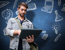 Composite image of student using tablet in library. Student using tablet in library  against blue chalkboard Royalty Free Stock Photo