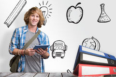 Composite image of student using tablet in library. Student using tablet in library against desk Stock Photo