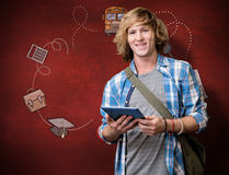 Composite image of student using tablet in library. Student using tablet in library against desk Stock Image