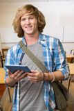 Composite image of student using tablet in library. Student using tablet in library  against empty classroom Royalty Free Stock Photos