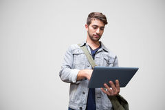 Composite image of student using tablet in library. Student using tablet in library  against grey vignette Royalty Free Stock Photo