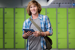 Composite image of student using tablet in library. Student using tablet in library against locker room Stock Images